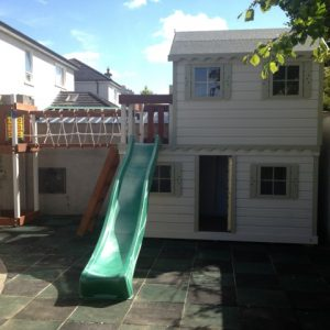 two story play house slide climbing net rockwall play deck