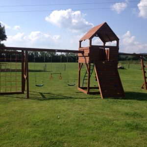 large play tower climbing vertical cargo net monkey bars swings