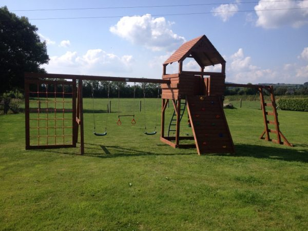 large play tower climbing vertical cargo net monkey bars swings