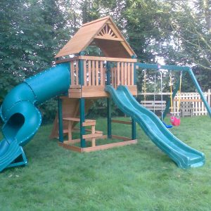 tube slide wave slide swings picnic table rockwall climbing ramp