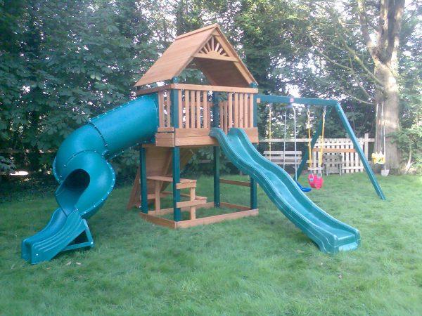 tube slide wave slide swings picnic table rockwall climbing ramp