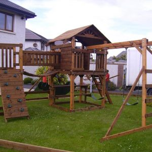 swings slide vertical rockwall monkeybars chain link bridge treehouse climbingnet