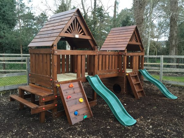 Creche and playschool double tower climbing frame with slides picnic table and bench