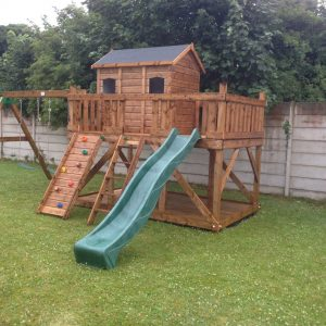Three house playhouse terrace swings slide rock wall access ladder