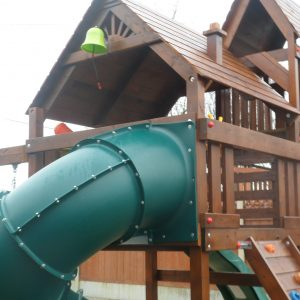 Spiral tube slide birds nest swings vertical rockwall monkeybars playhouse