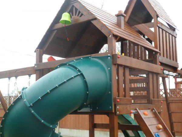Spiral tube slide birds nest swings vertical rockwall monkeybars playhouse