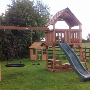 The Den tree house slide nest swing picnic table sandbox