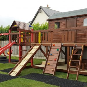 Large tree house, lower shop area ,bridge link climbing frame ,slide ,rock-wall access ladder