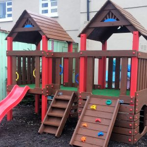 Creche outdoor climbing frame,two towers, crawl through,slide , climbing rocks,access ladder play house