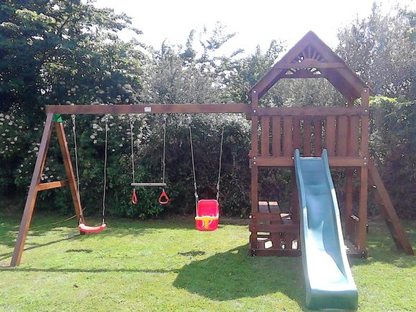STT Swings climbing frames and play centers with swings slide rock wall and picnic table with bench