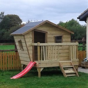 Crooked playhouse slide deck veranda den tree house